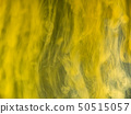 Yellow acrylic flows mixing with water, abstract 50515057
