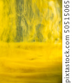 Abstract flows of yellow paint in liquid. Close up 50515065