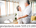 Lover senior couple dance together at home.  50515189