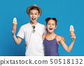 Happy little boy and girl embracing with ice cream cones 50518132