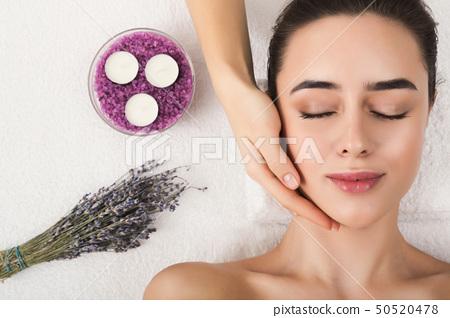 Woman getting professional facial massage at spa salon 50520478