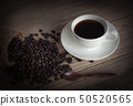 cup of coffee and coffee beans in a sack  50520565