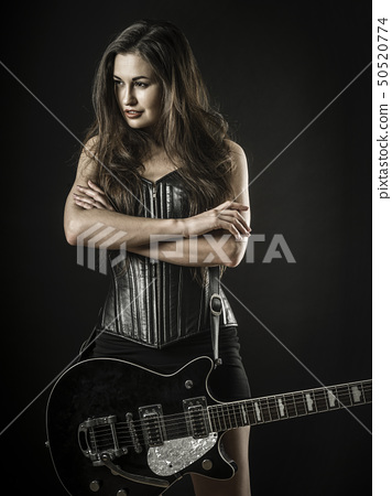 Sexy woman with electric guitar 50520774