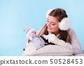Cute woman with little snowman. Winter fashion. 50528453