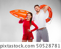 lifeguard couple with rescue equipment 50528781