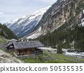 Alpine wooden cottage near GRAWA Glacier Waterfall situated in Stubai Valley, Tyrol, Austria. Spring 50535535