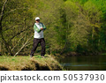 Fisherman trying to do a perfect cast, throwing 50537930