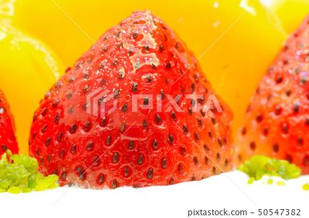 Strawberry and mango on the cake 50547382
