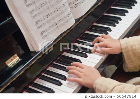 Hands playing piano 50547914
