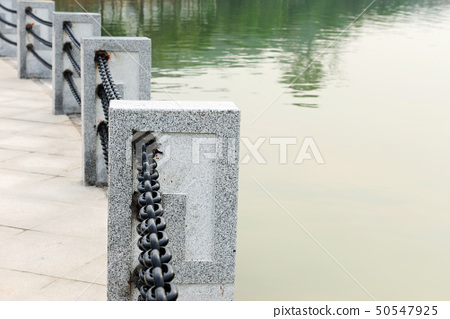 Handrail by the lake 50547925