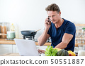 A man calling on cell phone while work from home 50551887