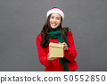 Happy beautiful Asian woman in Christmas attire 50552850