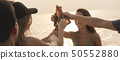 Group of friends having party at the beach 50552880
