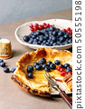 Dutch baby with berries 50555198