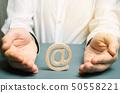 A man wraps his hands around an e-mail  50558221