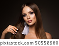 Hair. Beauty Woman with Very Long Healthy and Shiny Smooth Brown Hair. Model Brunette Gorgeous Hair 50558960