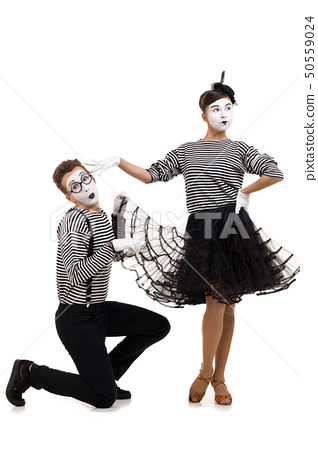 Smiling mimes in striped shirts. 50559024