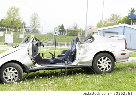 crashed car on field 50562361