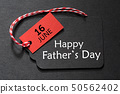 Happy Father's Day text on a black tag 50562402