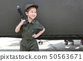 Little Asian child girl in pilot soldier suit 50563671