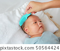 Mother combing for her infant. Comb and baby care. 50564424