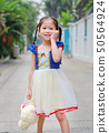 Asian child girl dressed a fantasy outfit. 50564924