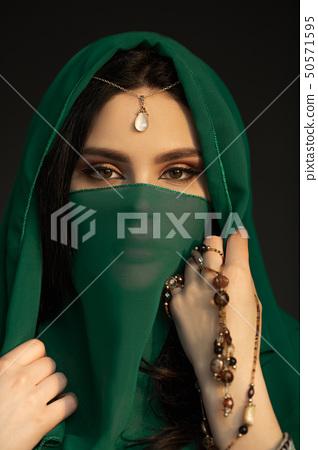 Beautiful Woman in Traditional Costume 50571595