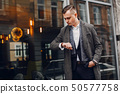 Stylish businessman working in a city 50577758