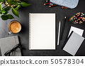 spiral notebook on black office background 50578304