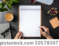 white paper with clipboard on black background 50578307