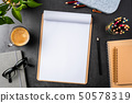 white paper with clipboard on black background 50578319