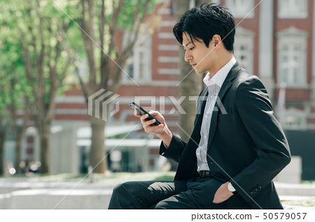 Young businessman looking at a smartphone 50579057