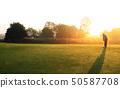 Golfer putting golf ball 50587708