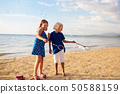 Kids blow bubble at beach. Child with bubbles 50588159