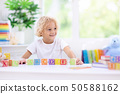 Child learning letters. Kid with wooden abc blocks 50588162