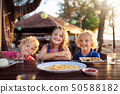 Family vacation lunch. Kids in beach restaurant 50588182