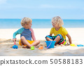 Kids playing on beach. Children play at sea. 50588183