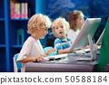 Computer class for school kids. Children study. 50588184