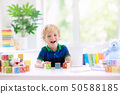 Child learning letters. Kid with wooden abc blocks 50588185