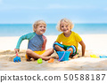 Kids playing on beach. Children play at sea. 50588187