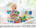Kids toys. Child building tower of toy blocks. 50588188