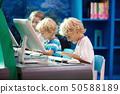 Computer class for school kids. Children study. 50588189