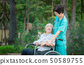 Smiling caregiver Senior nurse take care a Senior 50589755