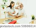 The visiting nurse taking care of senior man 50606014