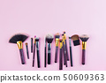 Set of makeup brushes on pink pastel background. Top view point, flat lay. 50609363