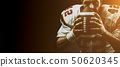 Portrait close-up, American football player, bearded without a helmet with the ball in his hands 50620345