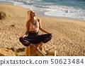 Woman enjoying the sunset on a beautiful beach 50623484