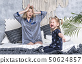 mother terrified of crying daughter 50624857