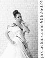 Wedding dress pose 50626024