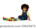 Lovely little cute girl with colourful blocks 50626873